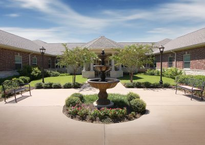 The fountain at the entrance of Pecan Ridge Memory Care
