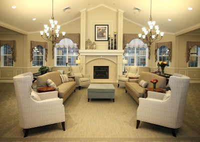The main living area with fireplace at Pecan Ridge Memory Care